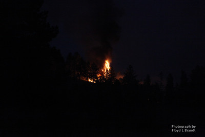 Havre Daily News/ Floyd Brandt  Crews were call to fight a forest fire approximately 30 miles of Havre Sunday. The cause unknown flames could be seen from the roadside East of the ski bowl.