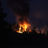 Havre Daily News/ Floyd Brandt<br /> <br /> Crews were call to fight a forest fire approximately 30 miles of Havre Sunday. The cause unknown flames could be seen from the roadside East of the ski bowl.