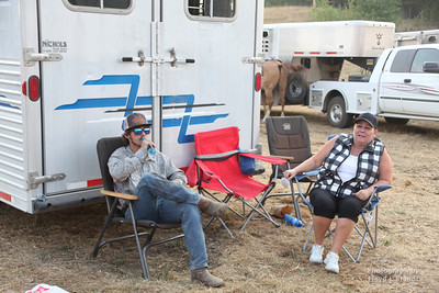 Havre Daily News/Floyd Brandt   Kolton Brough (left) has been at the Left Fork Fire waiting to see if the fire will shift towards the cattle that they have grazing near by Tuesday. He waits with his aunt Shannon LaSalle who had brought up pizza.