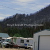 Havre Daily News / Floyd Brandt<br /> <br /> Landusky residents were able to return on Sunday after winds changed direction and fire fighters battled back the fire. Public Information Officer Geremy Olson said that the town was saved by the huge effort of the residents preparing for the fire that without their hard work the town may not of survived. This mountain on the South side of Landusky is now covered with burnt trees and scorched earth as is the mountain to the North with the fire coming to the edge of town on both sides.