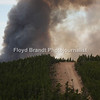 Havre Daily News / Floyd Brandt<br /> <br /> With the change in wind direction the fire back track over already burned area between the towns of Landusky and Zortman finding some new fuel in a bowl deep inside the Little Rockies giving crews a chance to construct fire breaks with the battle going to air power Sunday. Using mining roads crews widen the road and cut back brush, grass and trees hoping to contain the fire.