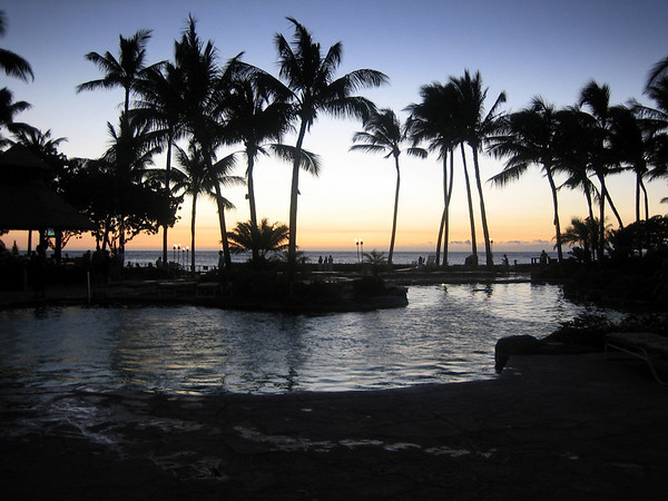 A view of the sunset over the pool at the Fairmont Orchid.