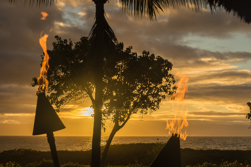 Tiki Torches and Sunset at Cocktail Hour