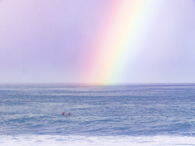 Rainbows and Surfers at Waimea