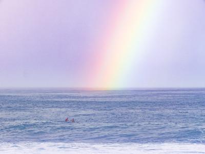 Rainbows and Surfers at Waimea