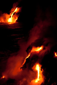 Kilauea Volcano lava flowing into the ocean at night
