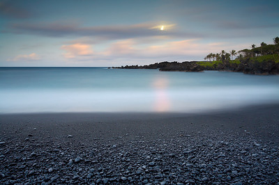 This black sand beach near Hana is extremely scenic but very difficult to photograph.  The contrast between the black sand and the rest of the scene is often too much for the camera to handle and most images turn out too black and too bright at the same time.  But a careful use of ND grad filters combined with a little remaining daylight after sunset working with the moonlight allowed the entire scene to be exposed properly.  It was a warm and beautiful evening to be out with the camera.