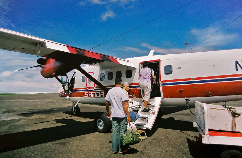 Boarding a Samoa Air DHC Twin Otter for a trip to Western Samoa. 2003, photographed with a Canon A2e.