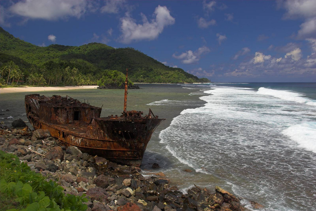 On the coastal road in American Samoa, an old boat must've run aground and been abandoned.