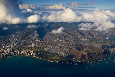 Just after departure from Honolulu International, Diamond Head and Waikiki Beach on bustling, overcrowded Oahu.
