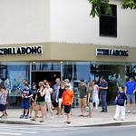 People waiting to cross the street in Waikiki Beach Hawaii