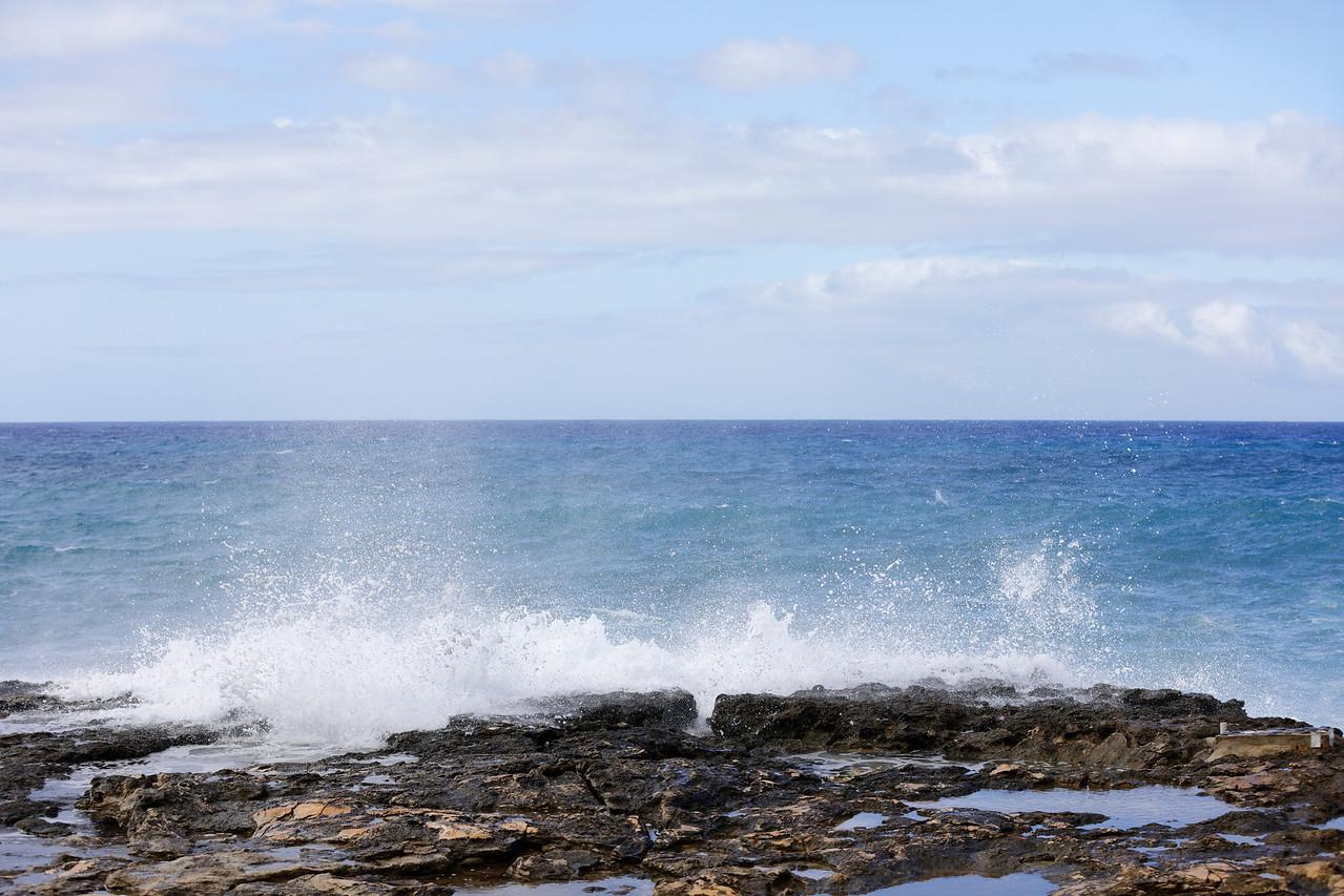 Hawaii waves crashing on the jetty