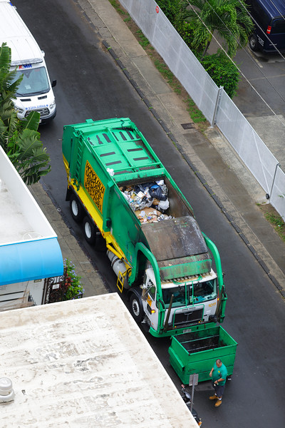 Garbage truck picking up trash