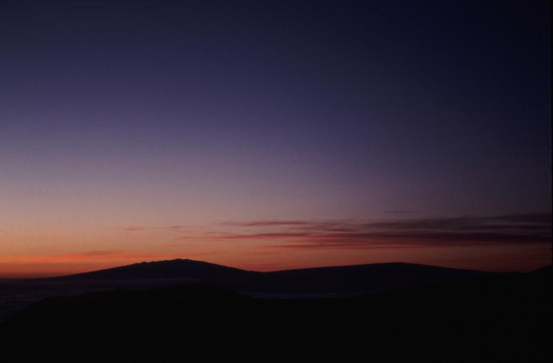 Mauna Kea and Mauna Loa rise above the clouds over a hundred miles away from the summit of Haleakala #HAL2000-5