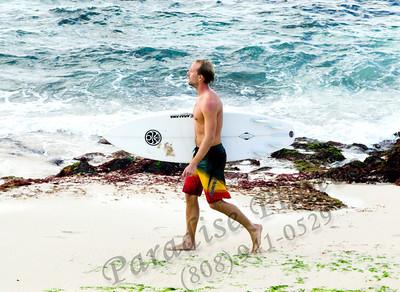 Surfer walkg on beach nef 012212 86