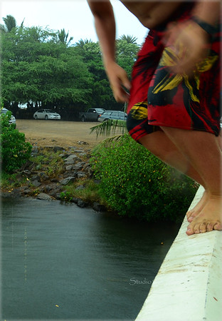 Keoni and Ryder jumping  from Haleiwa bridge -  Photo 1 of 3