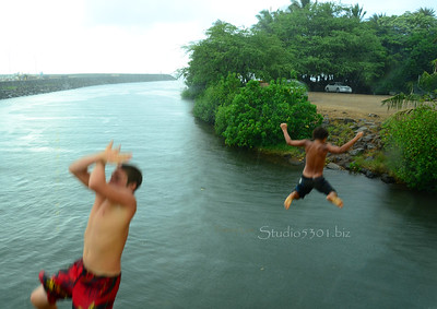 Keoni and Ryder jumping  from Haleiwa bridge -  Photo 2 of 3