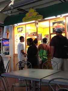 Waikiki Beach area toward Diamond Head away for the Hilton Hawaiian Village - Dole Pineapple Whip stand in the International Market