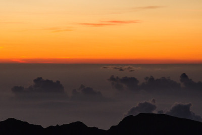 It was very cold and the wind was strong.  I took many photos, but there were only a few that were clear enough to use because I could not hold my camera steady.  Haleakala Sunrise Maui April 23, 2013