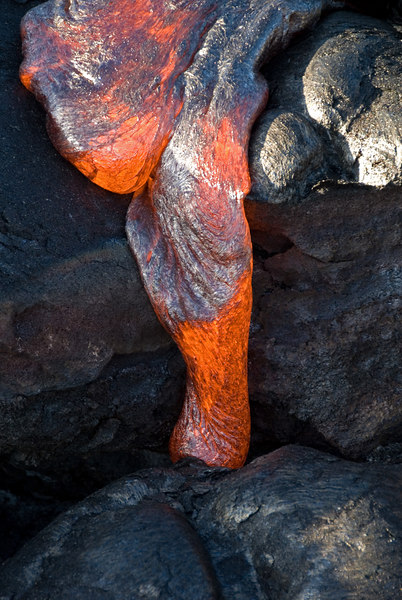 Pahoehoe lava oozing down a little drop-off.
