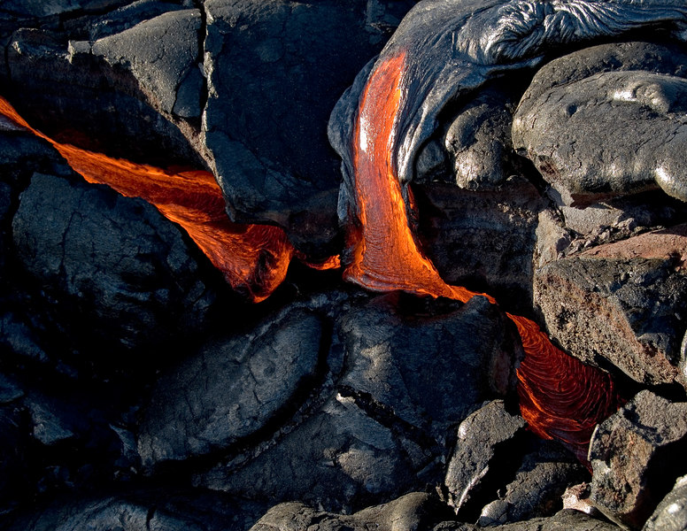 Pahoehoe lava filling up a small depression in the lava field.