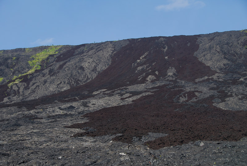 Another view of the Holei region of Volcanoes National Park from the bottom end of Chain of Craters road.  You can see clearly the two types of lava... The smoother and lighter type is called pahoehoe and the darker patches are aa (much rougher and it's said that is what the ancient hawaiians said when they walked on it with bare feet!)