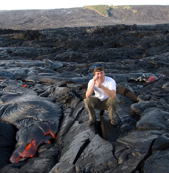 Me, awfully close to the fresh pahoehoe lava flow.  The lava is about 2000 degrees and VERY hot.  I could only stay this close for a few seconds before moving away.