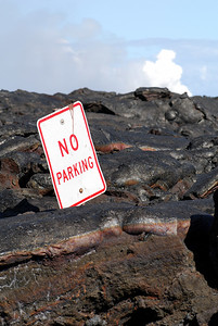 Road sign engulfed in the 2002 lava flow at the end of Chain of Craters road near Kalapana.