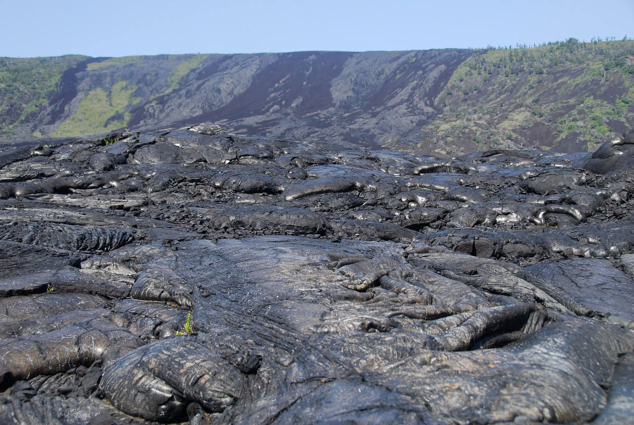 More pahoehoe lava with the Holei region in the background.
