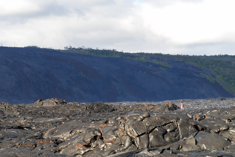 Arriving near the fresh lava site (4.5 miles into the lava fields) during the lava trek with Arnott's Adventures.  Our tour guide is in the distance and you can clearly see the heat coming up from the lava in the distance.  Kalapana and the Holei region is in the background.