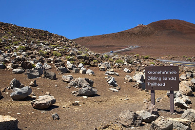 Trailhead of the Sliding Sands Trail at the summit of Haleakala.  To the right, the summit of Haleakala.