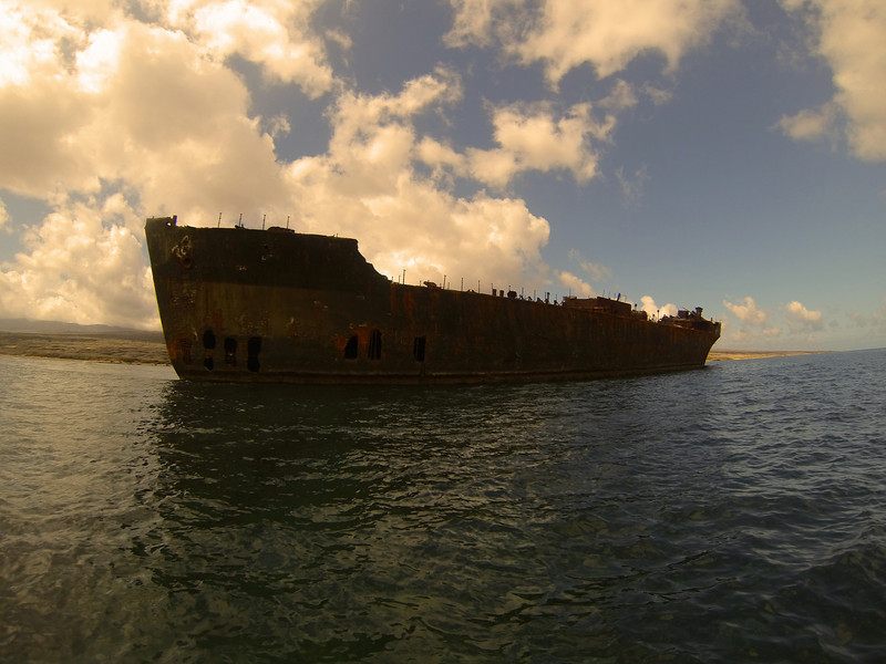 Rusting hull of a massive shipwreck on the North side of Lanai