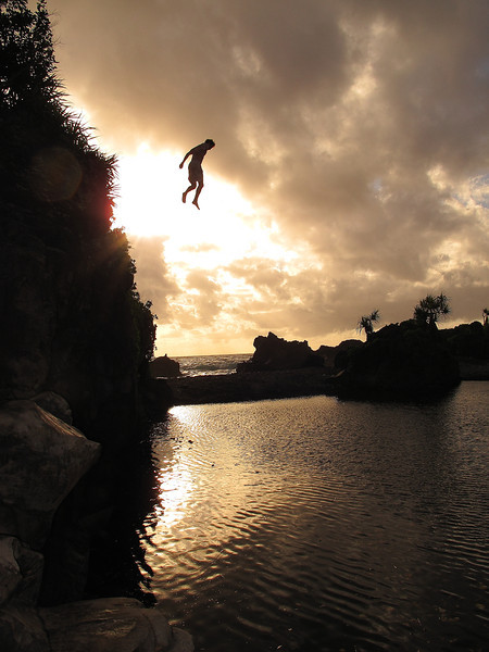 A cliff jumper, (Ben Eisenstein), gives off the illusion of levitating above Venus Pool, Maui