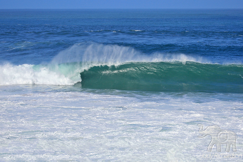 Beautifully formed tube wave at Waimea Bay