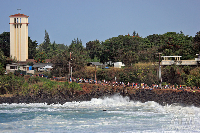 Spectators enjoying an incredible day of mammoth surf at Waimea Bay, O'ahu