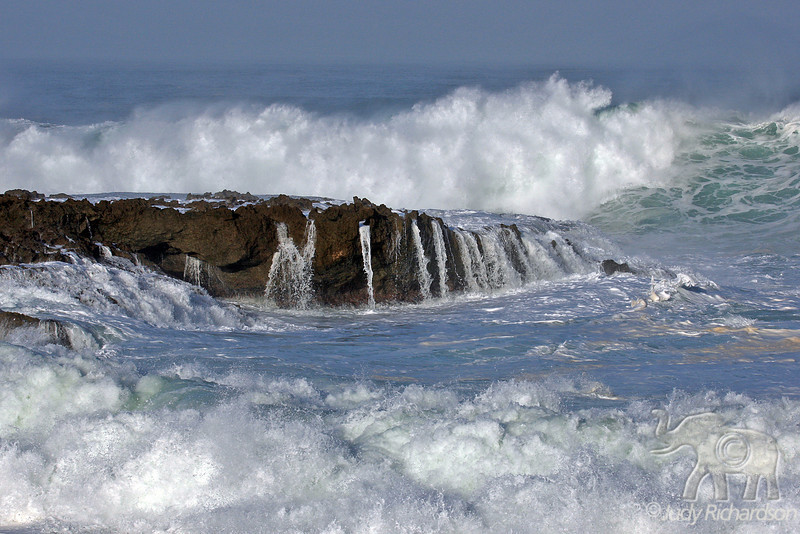 Foaming surf is created by massive waves at Shark's Cove on O'ahu