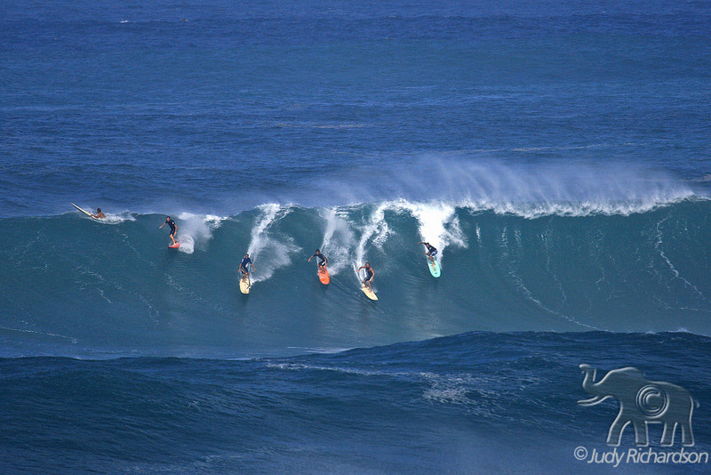 Five on the face of a beautifully formed wave at Waimea Bay