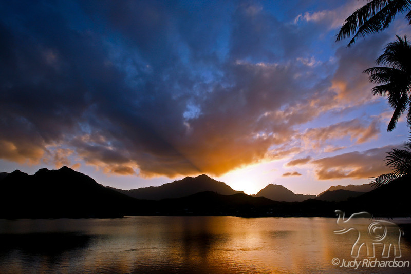 Spectacular sunset over the Ko'olau Mountains and Enchanted Lake in Kailua, O'ahu, Hawai'i.