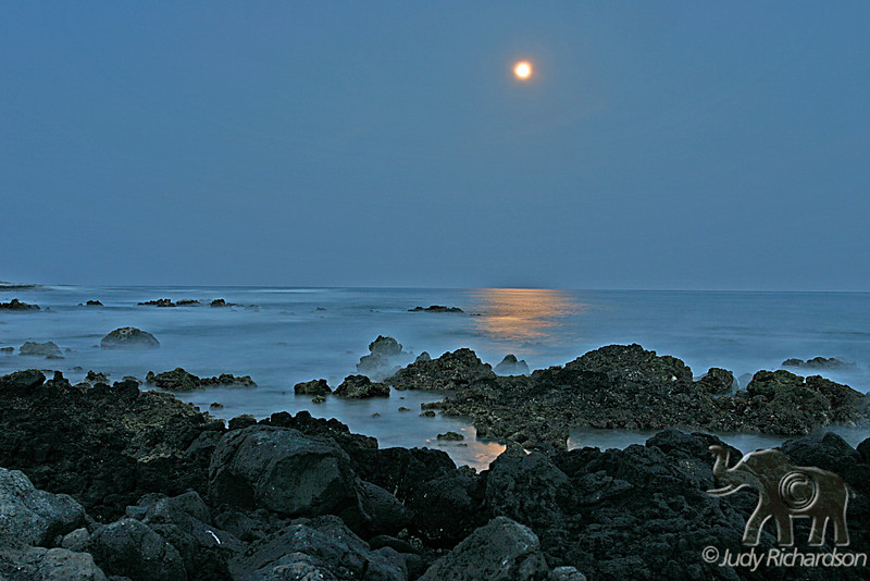 Soft Glow of Full moon over Sandy Beach