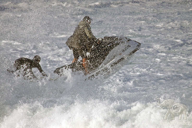 Wave rider towing a surfer through foam