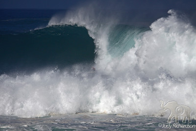Spectacular, massive waves at Waimea Bay~note surfer being buried by wave