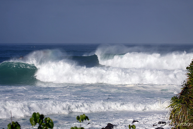 Sets of massive waves approaching Waimea Bay