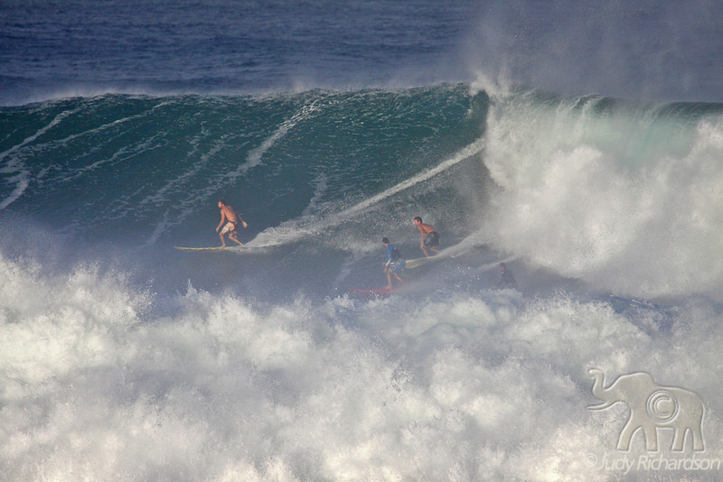 Beating the foam. See all 4 surfers?