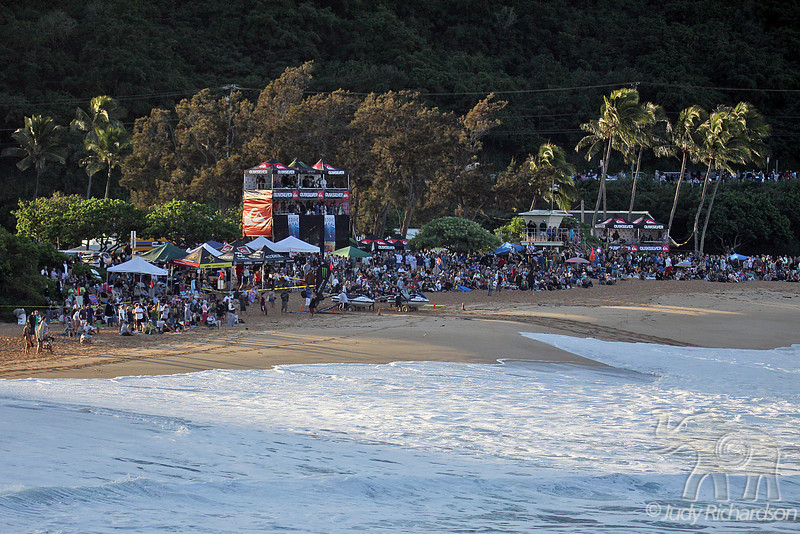 Early morning light peering through to Waimea Beach and spectators