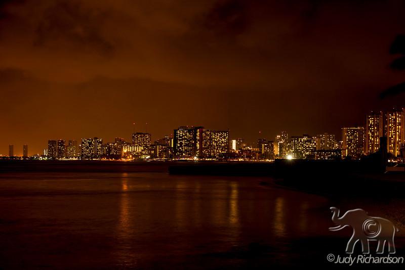 Night reflections of Waikiki Beach from Gold Coast