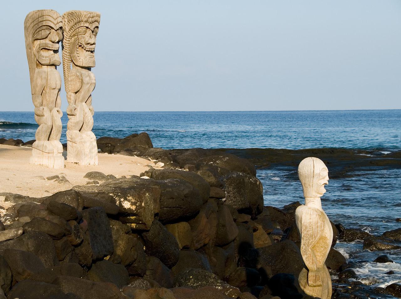 Tiki idols guarding a royal burial site at Pu'uhonua O Honaunau National Historic Park (City of Refuge)