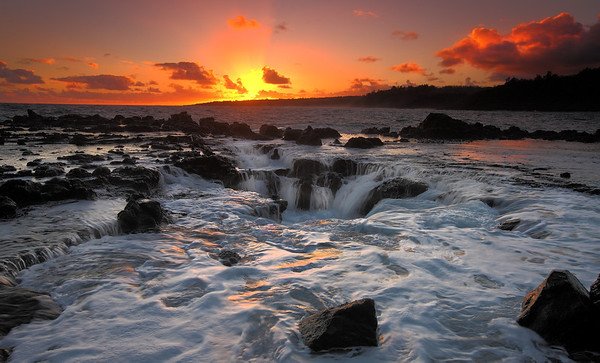 Sunrise on Kauai from a rocky shoreline