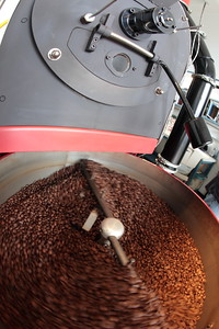 Hula Daddy Plantation, coffee roaster in action.  Kona, Hawaii.