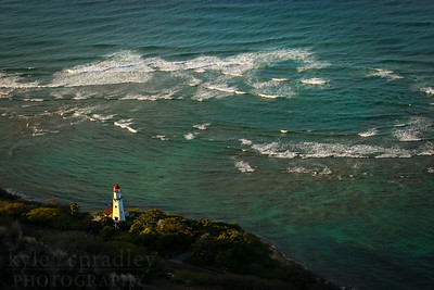 Sunrise view from Diamond Head on the island of O'ahu. The volcanic tuff cone is known by the Hawaiians as Le'ahi. At its peak, the cone is 762 feet above sea level. A popular hike takes visitors through tunnels and up steps to the peak. It is the defining icon of the beaches of Honolulu.  Photo by Kyle Spradley | www.kspradleyphoto.com