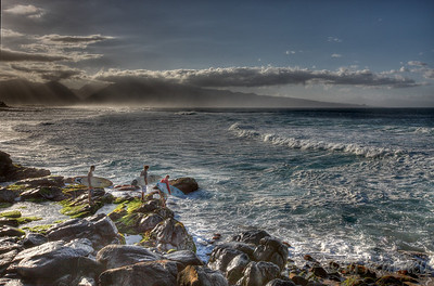Surfers at Ho'okipa, and the West Maui Mountains